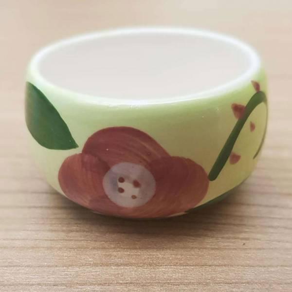 Produkt Abbildung Teelichthalter_gruen_mit_blume.jpg