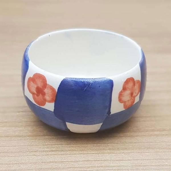 Produkt Abbildung Teelichthalter_blau_kariert_mit_blume.jpg